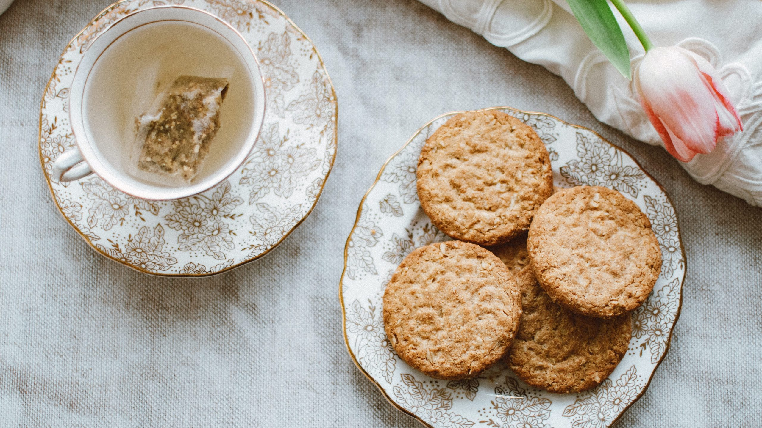 The image is of biscuits and a cup of tea. I have compared the price of rich tea biscuits from different supermarkets.