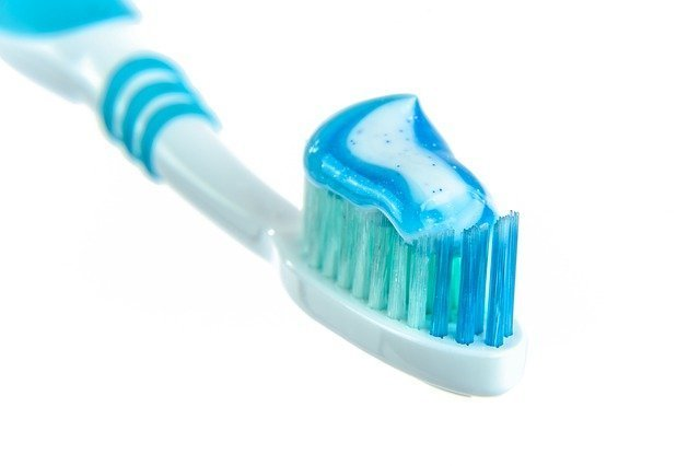 The image is of a toothbrush with toothpaste. I have recommended a toothpaste for those who are experiencing tooth pain due to sensitivity.